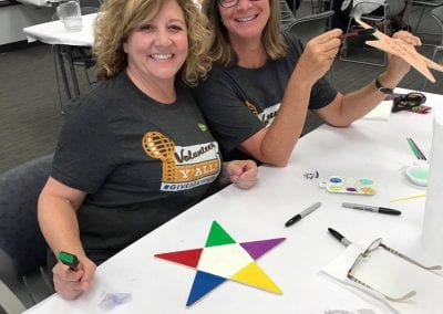 Volunteers making stars