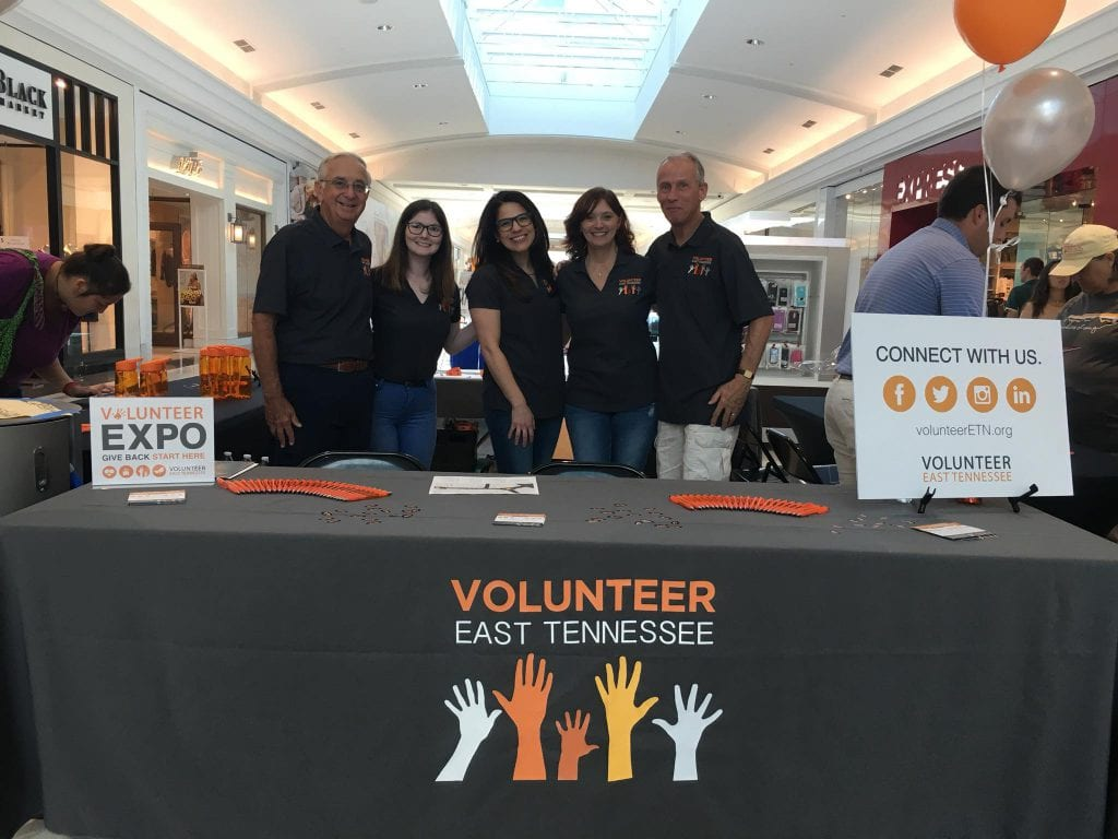 Volunteers booth at West Town Mall