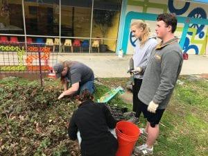 Volunteers cleaning garden