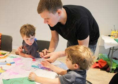 Volunteers helping kids with craft