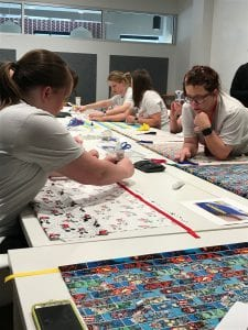Volunteers cutting wrapping paper